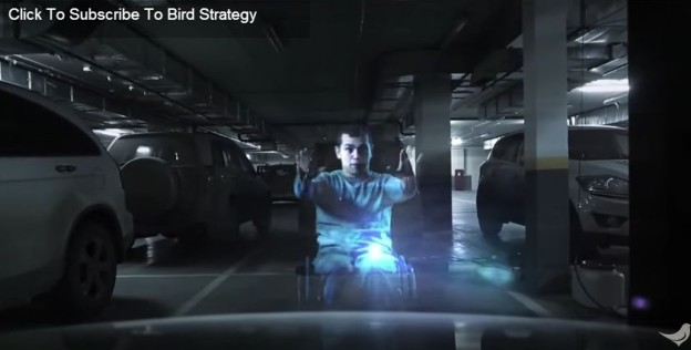 Hologram vozíčkáře na místě pro invalidy